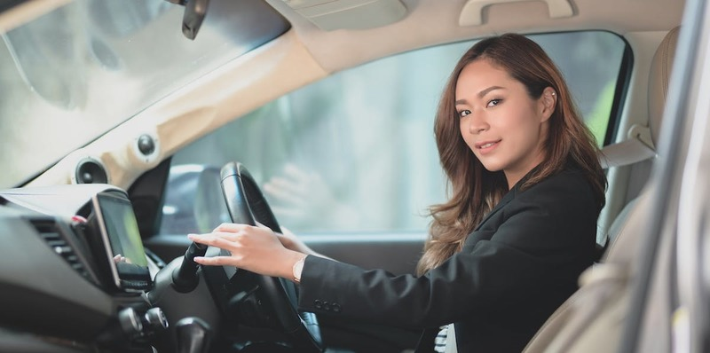 A young woman driving a manual car after learning to drive in a manual car