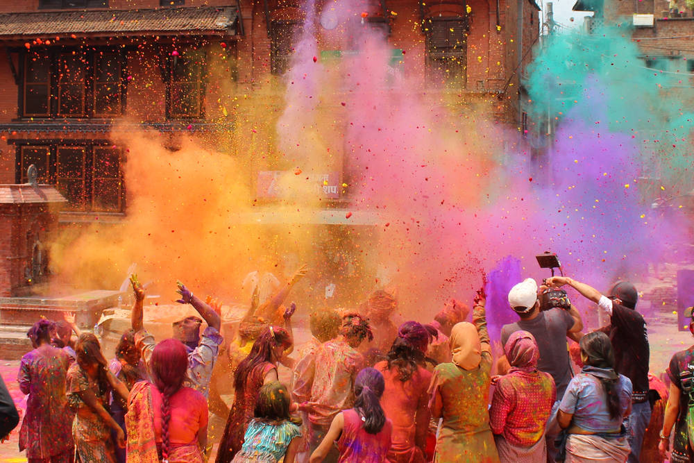 Crowd throws up paint during holi festival