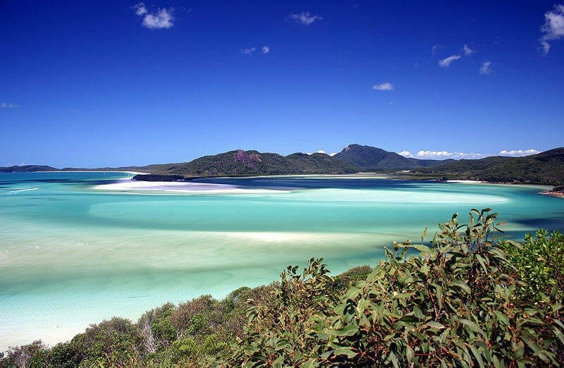 Beautiful Whitehaven Beach with turquoise water, white sand and greenery