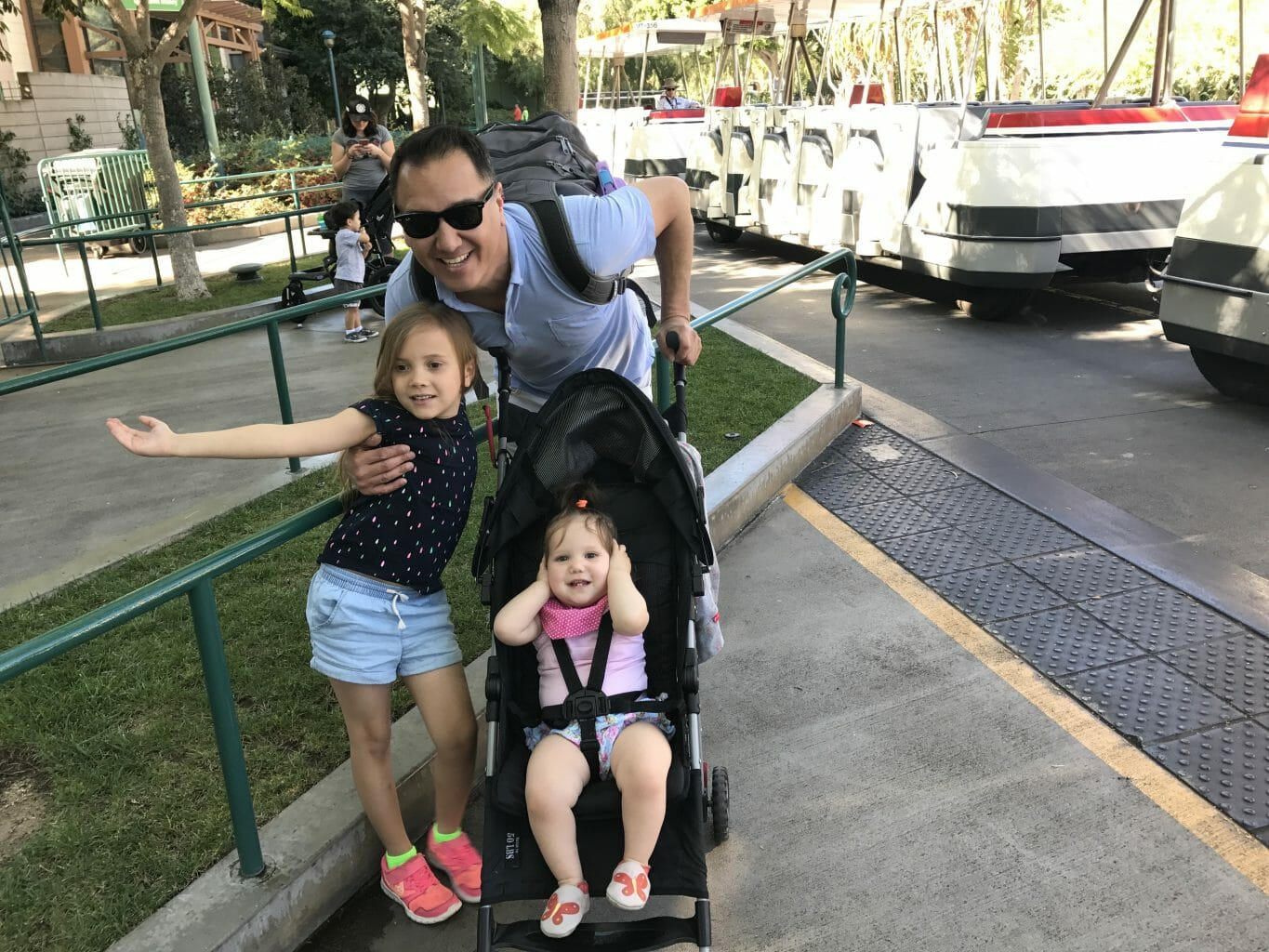Our family waiting for the tram to take us in to Disney's Anaheim Resort.
