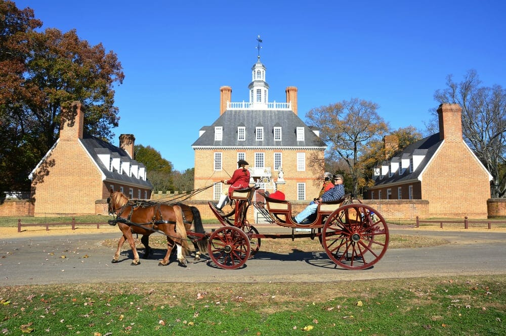 Horse and carriage pass Governor's building in Colonial Williamsburg