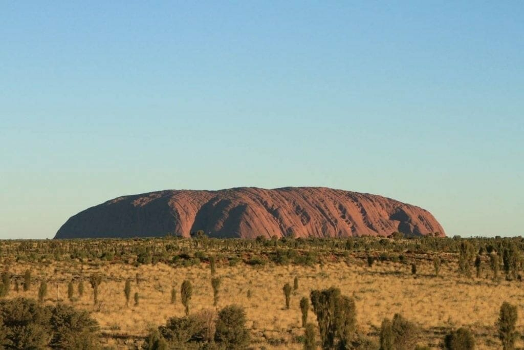 Uluru in the middle of the grassland
