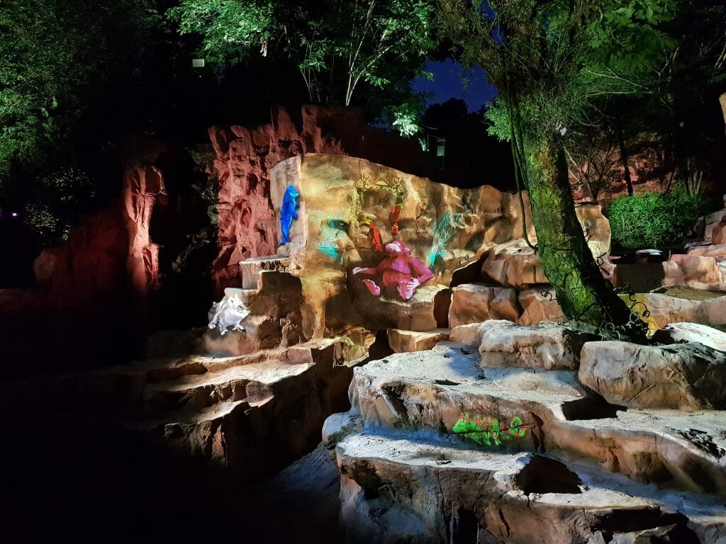 Light projections on rock wall in zoo