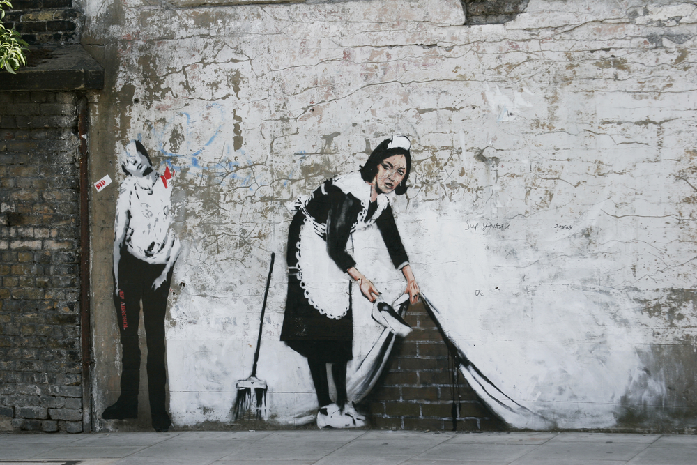 Maid Sweeping by Banksy
