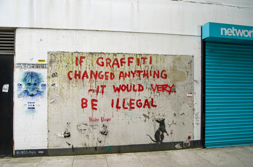 British artist Banksy painted on the side of a wall in Westminster, Central London