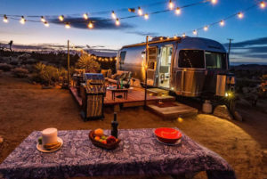 Night-time shot of campervan Airbnb for families in desert, California
