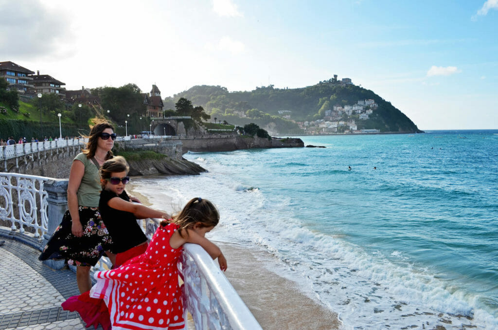 Family standing at beach in San Sebastian