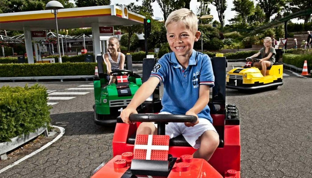 Kids playing on toy car at Legoland, Denmark