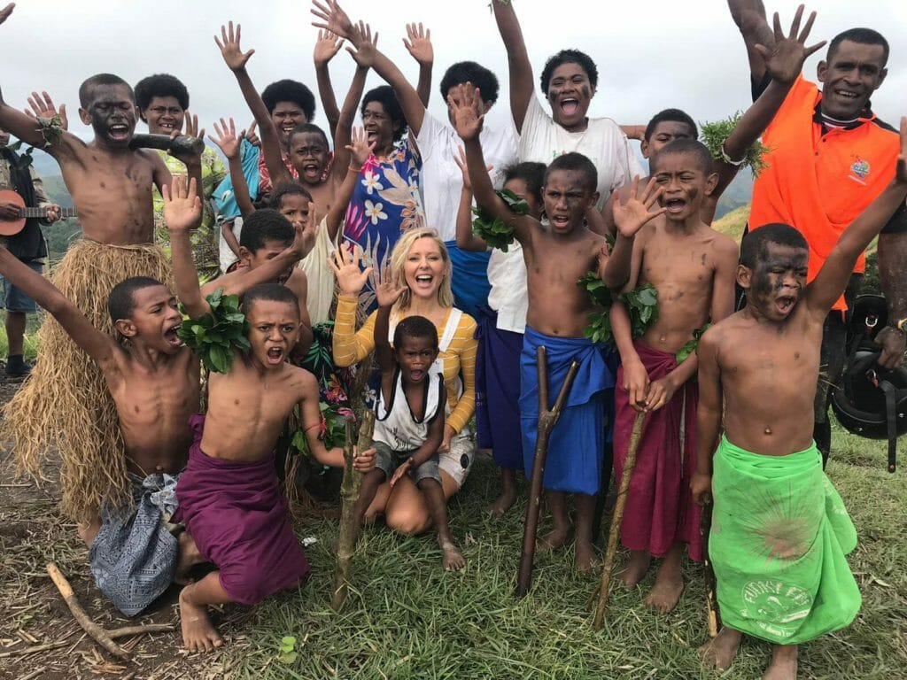 Tourist posing with group of locals in Fiji