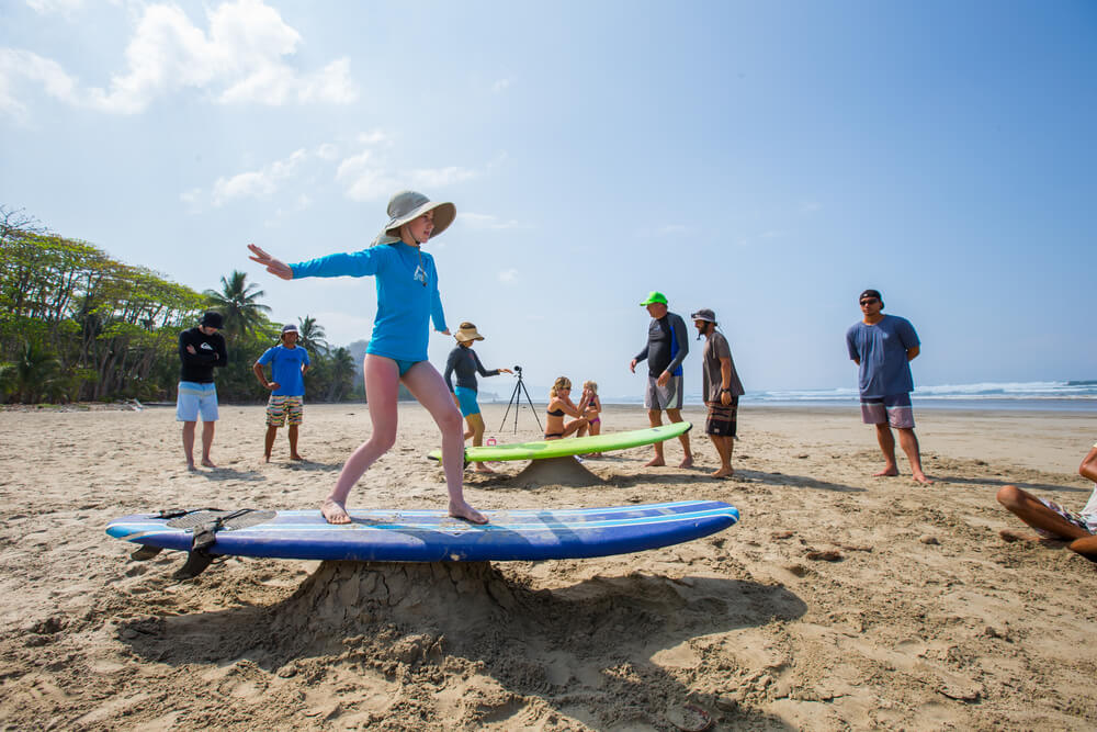 Kids learning to surf at Santa Teresa beach in Costa Rica