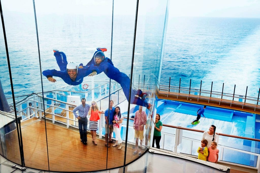 Man trying simulated skydiving experience on cruise ship