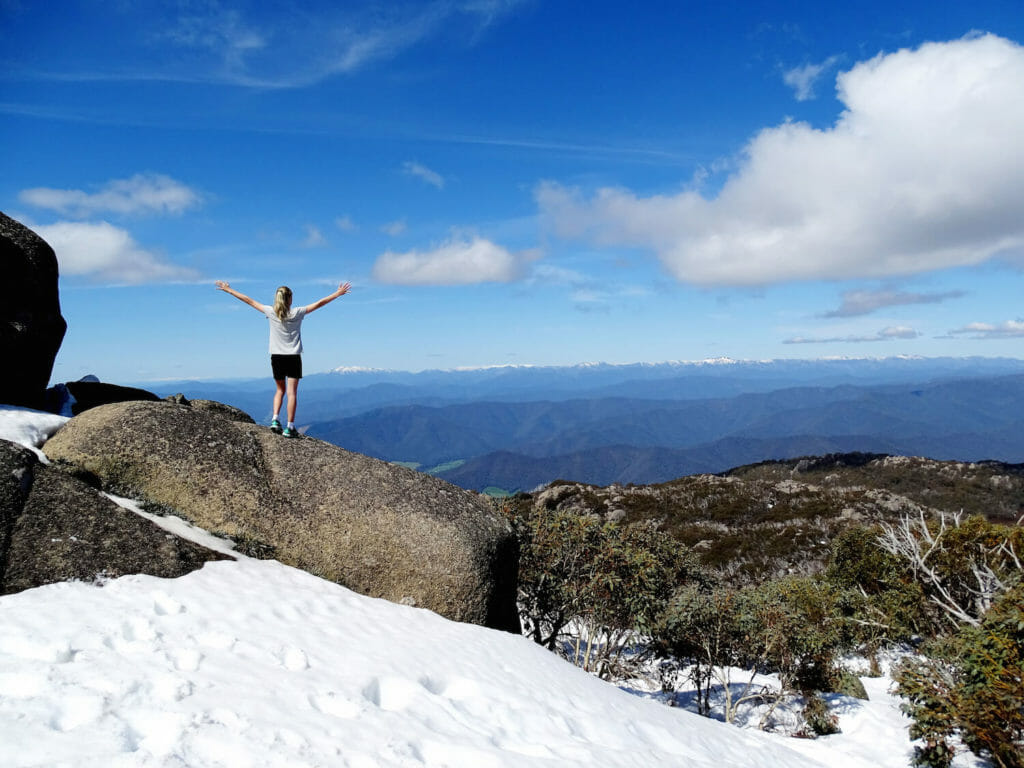 Girl standing on edge of mountain in victoria alpine region