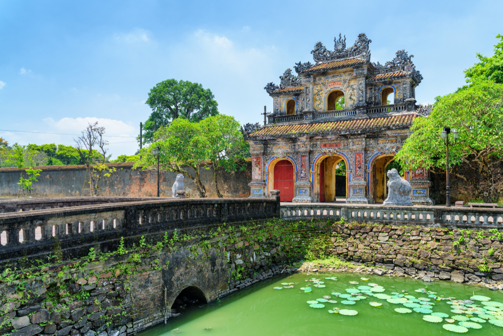 East Gate (Hien Nhon Gate) to the Citadel and a moat surrounding the Imperial City with the Purple Forbidden City in Hue, Vietnam.