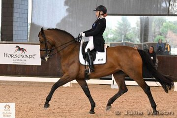 Jami Hurley rode her, 'JMH Royal Caress' to ninth place in the FEI Intermediate 1 on a very wintery day at the  2018 Boneo Winter CDI.
