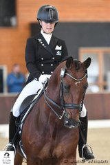 Shannan Goodwin from Queensland and no doubt feeling the cold, is pictured aboard, 'Aristede' that took seventh place in the  FEI CDI-W Grand Prix Freestyle with 70.085%.