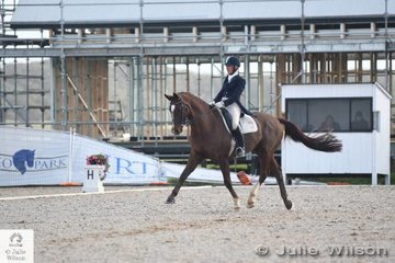 Well known rider and  coach, Caroline Coleby rode her, 'Don Grande' to take second place in the FEI Grand Prix CDN. Rings one and two had the large new restaurant and office construction complex in the background.
