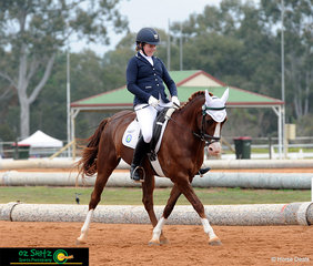 Kenda Park Edwardian and rider Jayde Mckinnon half pass aross the arena in Secondary Intermediate Novice on the first day of competition.