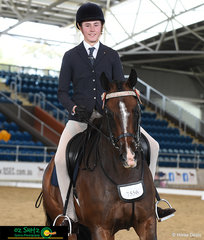 William Kropp completes another great workout with a smile riding his horse Alpha Centauri in the Secondary Show Horse.