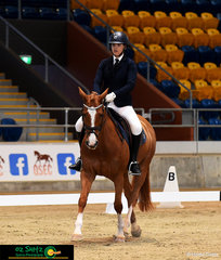 Pheobe Riordan and Warrego Tinkerbell step into the dressage arena riding for Fairholme College in the Elementary Freestyle on Saturday nights program.