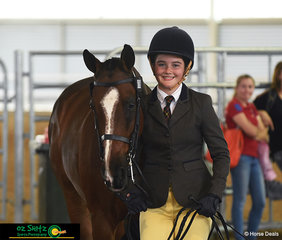 All smiles for Torra MacDonald as she enters the ring with Ellesby Chief Invader in the Secondary Show Hunter led phase representing Fairholme College.