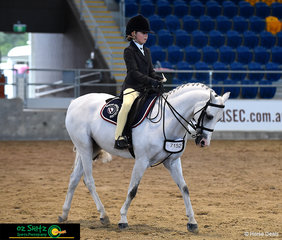 Morgan Lyall and Elray All Saint show off their moves for the judge in the rider phase of the Primary Working Hunter.