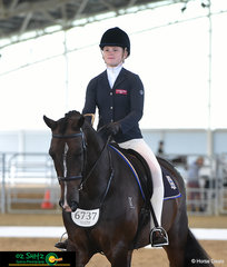 Always presenting herself and her horse immaculately, Sabrina Hitch enters the Secondary Working Hunter arena with Dicavalli Dandy riding for Kings Christian College.