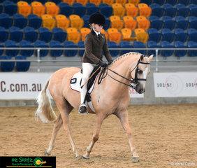 Maya Hoolihan rides her palomino pony Crestwood Royal Design in the Primary Show Hunter on Saturday.