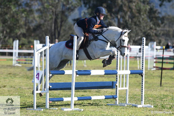 Charlotte Millington representing the Londonderry Pony Club and Zone 19 rode her, 'Stormy Lodge Doodlebug' to take third place in the 13 and Under 15 Years C Grade AM5 on day one of the PCA NSW State Showjumping Championships conducted at Morisset Showgrounds.