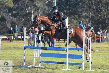 Representing Zone 25 and coming from the Mount Sugarloaf Pony Club, Imogen Robertson jumped  two good rounds aboard, 'Sonny' to win the 13 and Under 15 C Grade AM5.