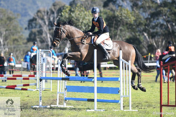 Edwina Irwin and 'Architrave' representing the Denman Pony Club and Zone 7 took second place in the 13 and Under 15 C Grade AM5 on day one of the PCA NSW State Showjumping Championships conducted at Morisset Showgrounds.