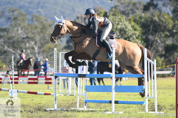 Aria Baker's, 'Emcee Flamboyance' jumps this oxer well during the 13 and Under 15 A Grade AM5. The combination from Camberwarra Pony Club and  representing Zone 28 took second place in the class.