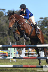 Jacqueline Coombes and 'Rainman' from the Bingara Pony Club and Zone 8 took second place in the 15 and Under 17 A Grade AM5 on day one of the PCA NSW State Showjumping Championships conducted at Morisset Showgrounds.