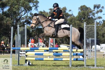 Isabelle Dimmock and , 'Darcy'  from the Denman Pony Club in Zone 7 took third place in the 15 and Under 17 C Grade AM5 on day one of the PCA NSW State Showjumping Championships conducted at Morisset Showgrounds.