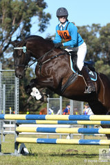 Olive Murphy and 'Sebastian' representing the Watagan Pony Club in Zone 24 make a stylish and winning jump on their way to victory in the 15 and Under 17 C Grade AM5.