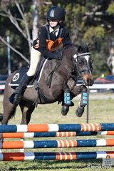 On the second day of the 2018  PCA NSW State Showjumping Championships conducted at Morisset Showgrounds, Dakota Robertson representing the Patterson River Pony Club ans Zone25 rode, 'Stormie' to win the Under 13 D Grade AM5 #2.