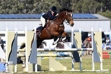Rhiannon Phillips representing the Londonderry Pony Club and Zone 19 won the C Grade Associate (17-15years) Accumulator class on day 2 of the  2018  PCA NSW State Showjumping Championships conducted at Morisset Showgrounds