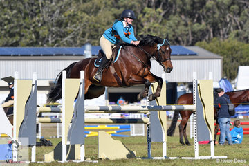 Brooke Joyner from the Wyong Pony Club and representing Zone 24 rode her Australian Stock Horse, 'Silverthorn Newsflash'  to take third place in the Associate B Grade Accumulator on day two of the  2018  PCA NSW State Showjumping Championships conducted at Morisset Showgrounds