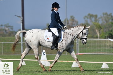 Emily Hubble riding her colourful Croydon Park Cool Ace was equal first in the Preliminary Pony 1.2.