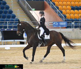 Balancing her time between show jumping Mini Prix's and riding Prix St George tests and completing her Teachers Degree at University Elizabeth Ballard is a very busy lady. Elizabeth is pictured here on her horse Seventh Heaven.
