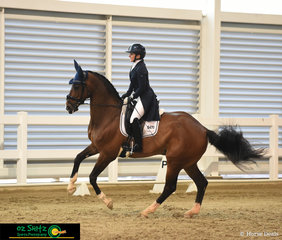 Justine Dean and Sharellen Gadabout perform a lovely pirouette in the Adult Amateur Owner Rider Advanced test..