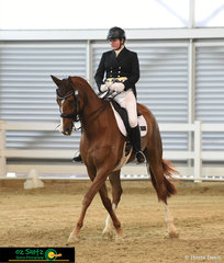 Sarah Wilson guides Royal Rythmic across the arena with a leg yield in the Adult Amateur Owner Rider Advanced test..