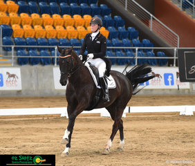 Eliza Cullen and her horse Dobria Dejeu fly across the arena competing in the Intermediate 1 class.
