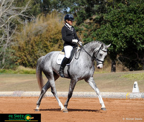 Fromelles, ridden by Samantha Jane Winton, stretches out as they trot up the arena in the Hoof Gold Open Novice 2.2.