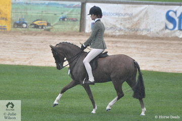 Ebonie Lee copped the worst of the morning rain, but came out a winner. She rode Jessica Sharp's, 'Imperial Vagabond' to win the class for Novice Show Hunter Pony 12-12.2hh.