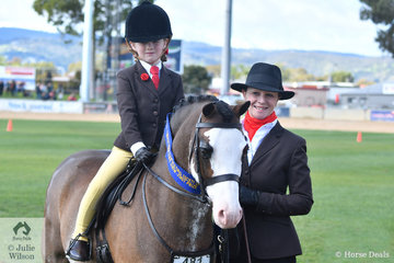 Charlie Hunt, leading and daughter Maison riding, teamed up with Andrea Merry's super, 'Splashdance' to win the class for Leading Rein Show Hunter Pony.