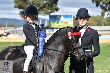 With a little help from Kate Halliday, Abbi Schaefer won the class for Girl/Boy Rider 5 AU 8 Years.