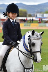 Audrey Camera rode her sister Violet's, 'Kerulen Cossette' to win the class for Open Pony 11-11.2hh.
