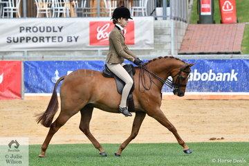 Kate Kyros is pictured aboard her Novice Show Hunter 13-13.2hh winner, 'Braeburn Oscar de la Renta' during the Best Novice Show Hunter Pony ride off.