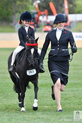 """""""Winners are grinners"""", and Abbi Schaefer knew she was on a good thing. With an elegant Kate Halliday along for support, Abbi rode  Kerry Halliday's, 'Dalbrae Vegas' to win the class for Leading Rein Pony Hack."""