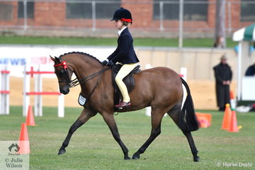 Annabelle Richardson is now in the Royal Show broad sash club, as she rode Emma Richardson and Maddie Ginn's nomination, the very well performed, 'Harrington Park Symphony' to claim the Small Pony Reserve Championship.